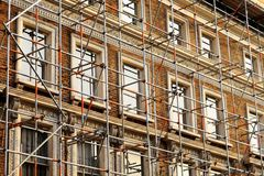 Scaffolded house wall fragment Royalty Free Stock Image