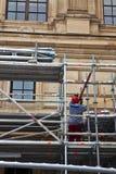Scaffolder at work. A scaffolder workinin on the old Opera house in Frankfurt Stock Image