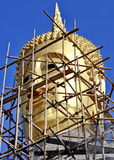 Scaffolders around Buddha statue Royalty Free Stock Photos