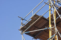 Scaffolding. And ladder on outside of house stock photography