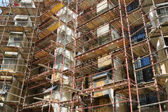 Scaffolding. Building under construction with scaffolding on its exterior Stock Photography