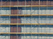 Scaffolding. On a building site with red bricks Royalty Free Stock Photo
