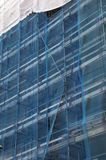 Scaffolding. Scaffold with blue safety net Stock Image