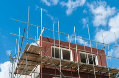 Scaffolding. Newly build homes with scaffolding Royalty Free Stock Photography