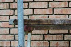Scaffolding. In front of a brick wall Stock Image