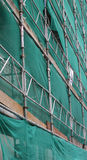 Scaffolding. And Green Cladding royalty free stock photography