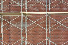 Scaffolding. Bricklayers scaffolding in front of a newly constructed brick wall Royalty Free Stock Photos