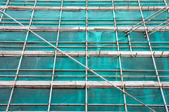 Scaffolding. And netting covering a church stock photo
