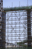 Scaffolding. High up in a blue sky Stock Images