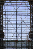 Scaffolding. High up in a blue sky Royalty Free Stock Photos