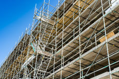 Scaffolding. Against a building with blue sky stock photos