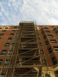 Scaffolding on apartment building. Scaffolding on the side of apartment building Royalty Free Stock Image