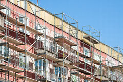 Scaffolding on apartment building Stock Photos