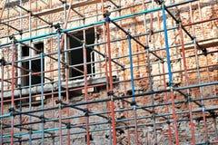 Scaffolding around brick facade Royalty Free Stock Photo