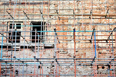 Scaffolding around brick facade Royalty Free Stock Photos