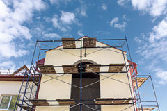 Scaffolding around a building renovating facade Royalty Free Stock Images