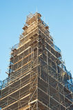 Scaffolding around an historic tower. Complex scaffolding around an historic tower in the City of Inverness Royalty Free Stock Photo