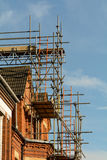 Scaffolding around house Royalty Free Stock Photos