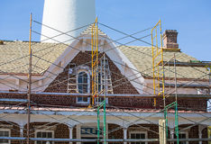 Scaffolding on Brick Keepers House by Lighthouse Royalty Free Stock Photography