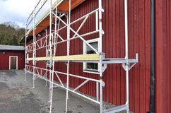 Scaffolding build in action at workplace. A set up of Scaffolding, for work on painting houses stock photography