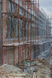 Scaffolding on building. Building covered in scaffolding at cons Royalty Free Stock Photos