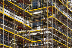 Scaffolding on building , building facade with scaffolds Royalty Free Stock Photo