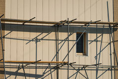 Scaffolding on a building facade. Royalty Free Stock Photography