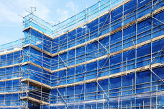 Scaffolding. Building frame on a building industry construction site royalty free stock photo