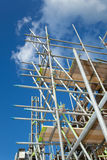 Scaffolding on a building site. Scaffolding construction with  blue sky Stock Images