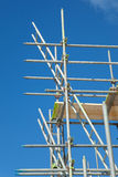Scaffolding on a building site. Scaffolding construction with  blue sky Stock Image