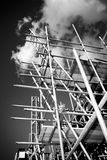 Scaffolding on a building site. Scaffolding construction with ladder against sky Royalty Free Stock Image