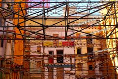 Scaffolding. Close up of a lot of metal construction beams amonst buildings in Barcelona, Spain stock photo