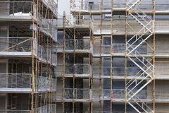 Scaffolding close up and stair at construction building site royalty free stock photo