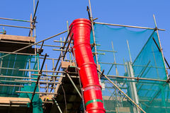 Scaffolding. Complete with rubbish waste chute stock photos