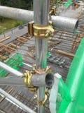 Scaffolding connector. SELANGOR, MALAYSIA -JULY 10, 2016: Scaffolding connector detail at the construction site. The connector bind or tie scaffolding or safety stock photos