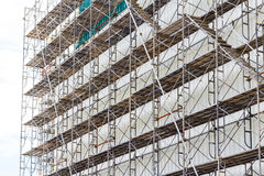 Scaffolding for construct a building under construction. Scaffolding for construct a building under construction Stock Photo