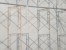 Scaffolding in the construction. With concrete wall Stock Photos