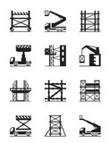 Scaffolding and construction cranes icon set Stock Photos