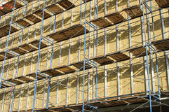 Scaffolding at a construction site. The wall being built homes equipped scaffolding Stock Photos