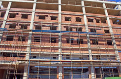 Scaffolding Erected Around Brick And Concrete Building Under Con. Struction Stock Image