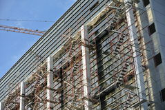 Scaffolding erected at the external wall of the building Royalty Free Stock Photo
