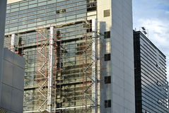 Scaffolding erected at the external wall of the building Stock Image