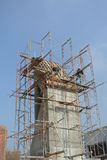 Scaffolding erected at the external wall of the building Stock Photos