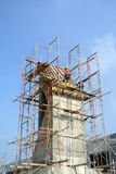 Scaffolding erected at the external wall of the building Royalty Free Stock Images