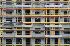 Scaffolding on facade,  building under construction Royalty Free Stock Photos