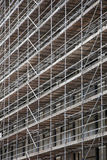 Scaffolding on facade of high rise building Royalty Free Stock Photo