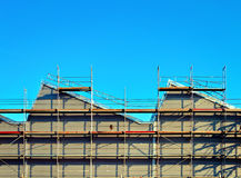 Scaffolding on a factory wall Royalty Free Stock Photos
