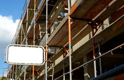 Scaffolding. Framework with construction sign and copy space Royalty Free Stock Photography