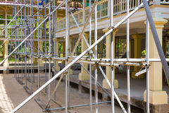 Scaffolding in front the building during the renovation Stock Photos