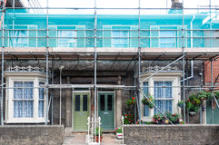 Scaffolding on front of a row of houses Stock Images